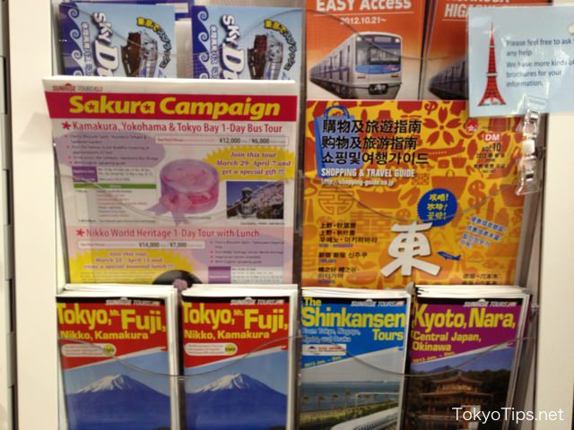 Many brochures written in English, Chinese, and Korean are there.