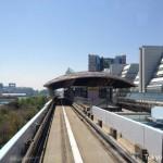 Yurikamome stops at Kokusai-tenjijo-seimon Station.