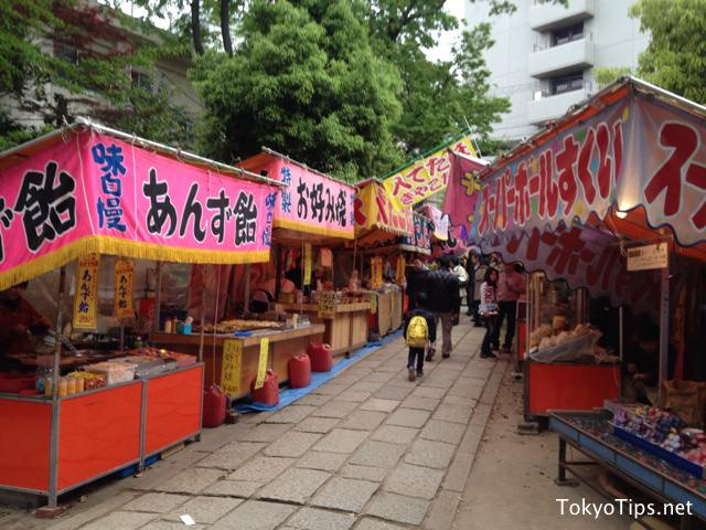 Many stands opened in this shrine. This scene is an old-fashioned style of Japanese festivals at shrines or temples.