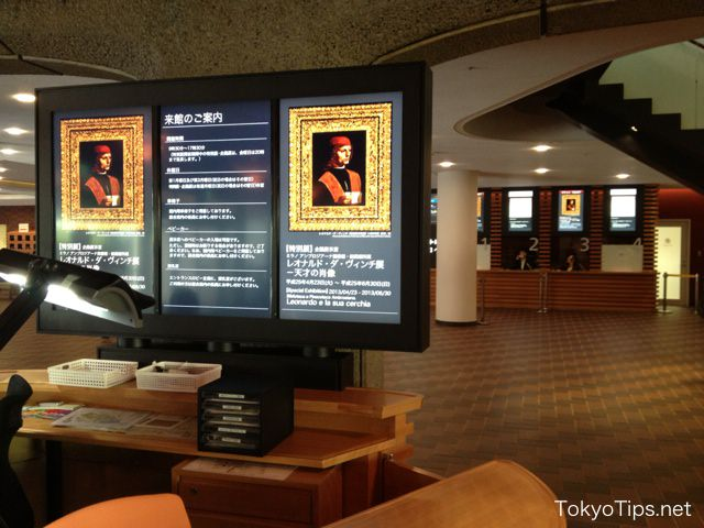 Display of information counter. Box-office windows are in back.